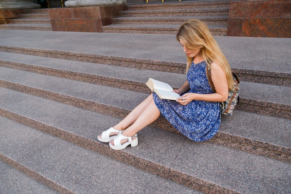 Girl learning on stairs