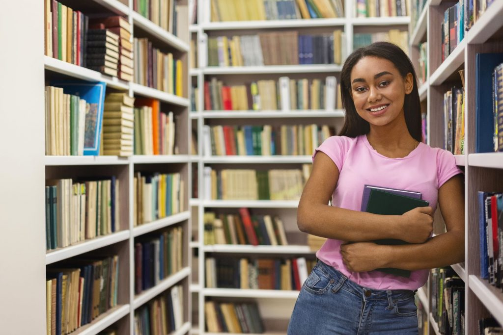 Teenager smiling in the library