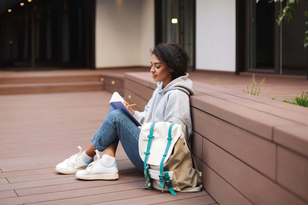 girl writing notes